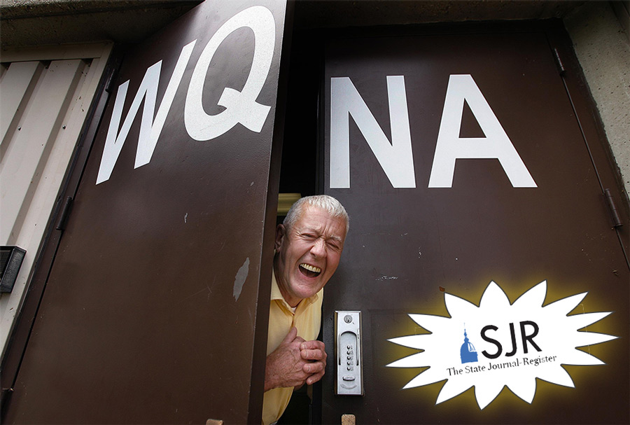 Dr. Swing peeking out of the WQNA station doors with a large smile on his face.